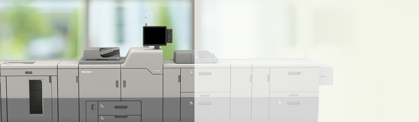 ricoh pro 7210s 4 station printer in front of window with greenery in background