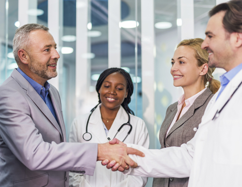 Group meeting of professionals and doctors shaking hands